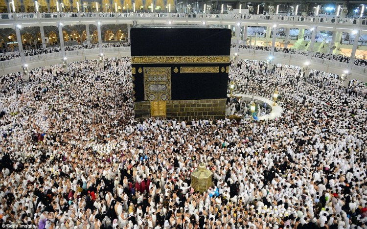 Hajj pilgrims circumambulate the Ka'bah.