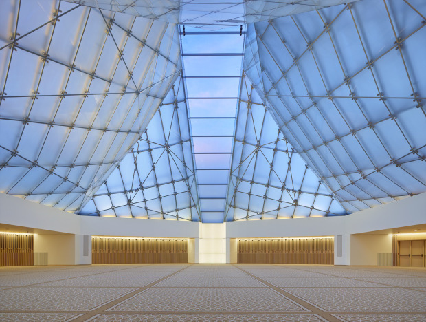The interior of the prayer hall of the Toronto Ismaili Centre, with the Mihrab and the Qiblah Wall at the front.