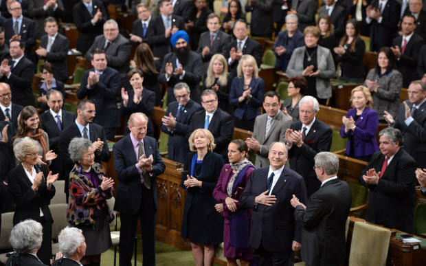 The Aga Khan, spiritual leader of the Ismaili Muslims, is applauded as he arrives to deliver an address in the House of Commons on Parliament Hill in Ottawa on Thursday, February 27, 2014. THE CANADIAN PRESS/Sean Kilpatrick ORG XMIT: POS2014022714475975