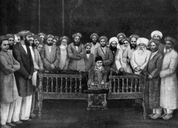 The 7-year-old Aga Khan III (1877 - 1957) at his enthronement ceremony as Imam of the Shia Ismaili Muslims in Bombay, 1st September 1885. He is surrounded by community elders and seated on the oblong wooden throne of imamate. (Photo by Keystone/Hulton Archive/Getty Images)